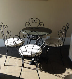 4 Wrought Iron Chairs