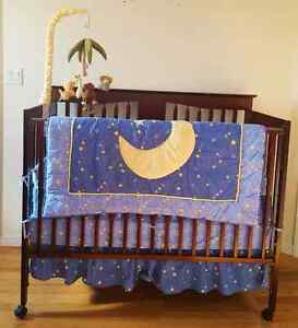 Baby crib , mattress,  mobile and bedding.