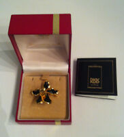 Authentic Orchid encapsulated in 22 carat gold necklace/brooch