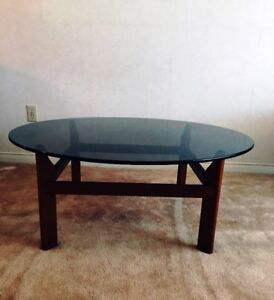 Teak based round glass coffee table