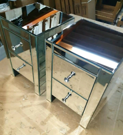 A new pair of small mirrored 2 drawer bedside tables.