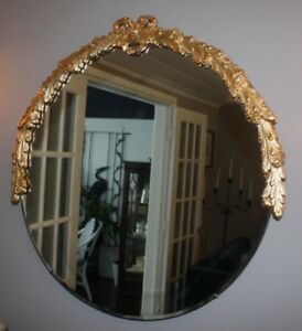 GOLD LEAFED ANTIQUE BOW MIRROR