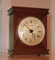Made in Germany Mantel clock - perfect working order. Wood case.