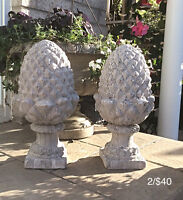 Two Cement Acorn Statues
