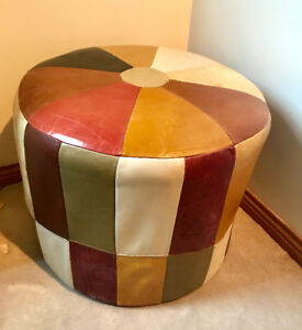 Pair of leather ottomans