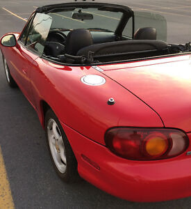 Red Mazda Miata convertible.