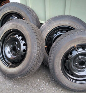 1-yr winter tires with rims for sale