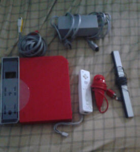 original nintendo wii red with controllers and two games
