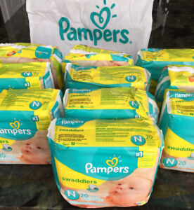 **200 couches Pampers swaddlers + 106 lingettes Pampers!!!**