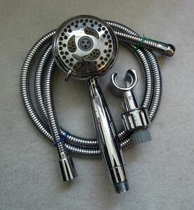 HAND HELD REPLACEMENT SHOWER HEAD AND FLEX LINE