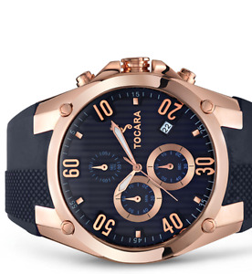 Jacob rose gold watch with navy blue strap.