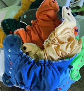 Fitted style cloth diapers and accessories