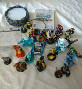 Skylander spyro adventures & figures lot, $115
