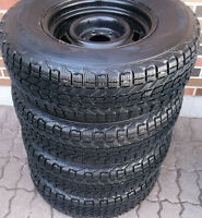 235 75 15 - FIRESTONE WINTERFORCE - SNOWS ON RIMS - 5X115