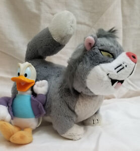 LUCIFER  and MINI DONALD DUCK PLUSH