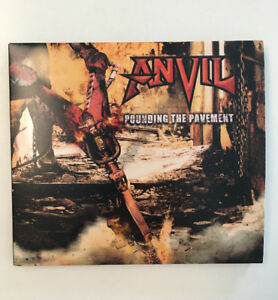 Anvil Pounding the Pavement cd signed by all 3 current members