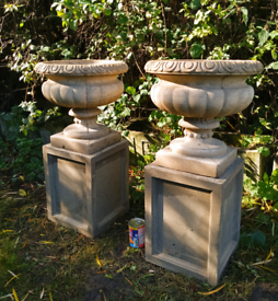 Heavy Matching pair of stone plinths with urn planters