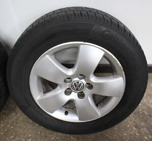 5x100 VW Jetta Stock Wheels with tires