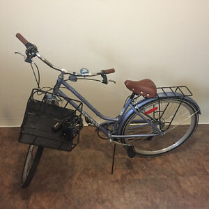 A basket bicycle for women.