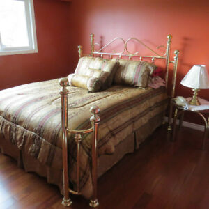 Queen bed frame with side table and bedding