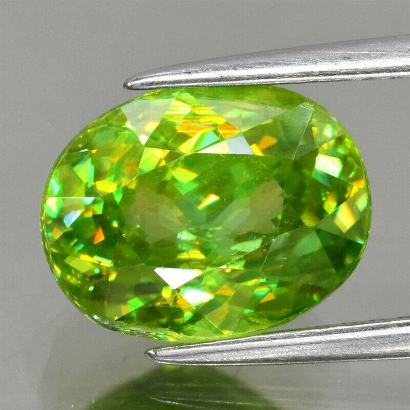 4.08ct 10.2x8mm Oval Natural Yellowish Green Sphene Madagascar, Diamond Luster