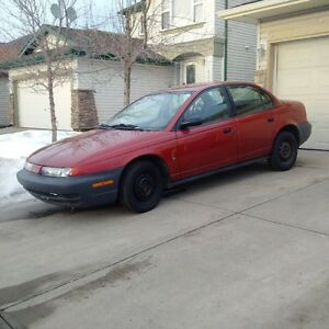 1999 Saturn plus a free 2000 saturn for salvage