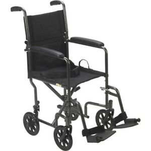 NEW&USED- Light DM Transport WheelChair or Portable Wheel Chair.