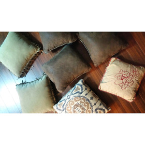 Assorted throw pillows and cushions