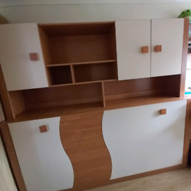 Folding bed with a shelf
