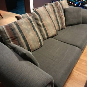 Matching green couch and loveseat