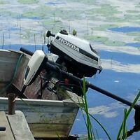 Aluminum boat with Honda 2 hp Outboard