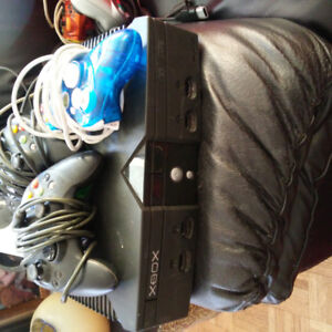xbox console ,3 controllers, lots of games. no plug in cords