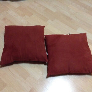 Set of red throw pillows