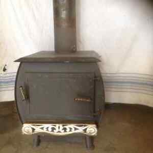 Wood burning stove with temperature controlled damper