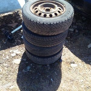 """4 14"""" 4 bolt rims with tires"""