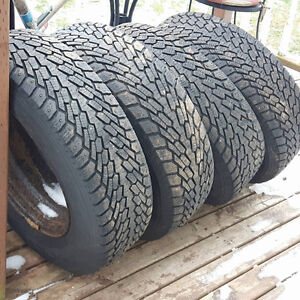 Set of four winter tires, studded, on steel rims 215/70/R15
