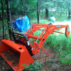 New loader attachment forks, harness, an tractor nose guard.