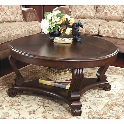 Ashley Brookfield Round Coffee Table Mahogany Tables in Dark Brown
