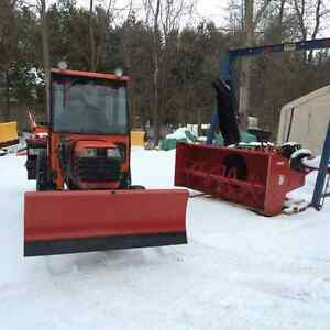 Kubota L2910 tractor with snowplow and blower