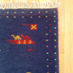 Navy, gold & red accent rug