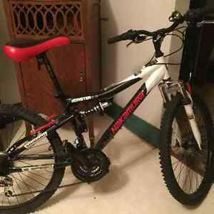 "Nakamura Monster 2.2 Mountain Bike, 18 speed, 24"" wheels. Youth."
