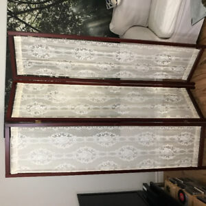 Beautiful wood and lace folding divider screen.