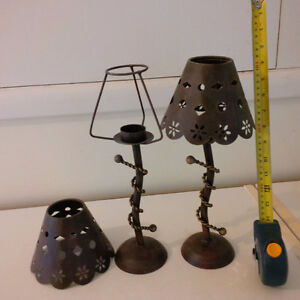 Candle stands, holders.  Made out of metal, heavy and durable. B