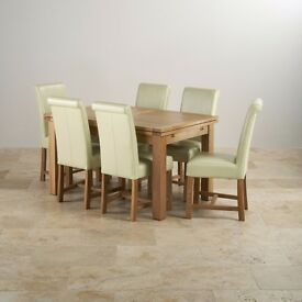 Oak furnitureland solid oak extendable dining table and 6 cream leather chairs