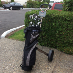 Right handedg golff clubs with cart.  Irons and drivers included