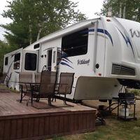 !!!!!!WOW!!!!2011 WILDCAT 34FT 3 SLIDES FRONT LIVINGROOM