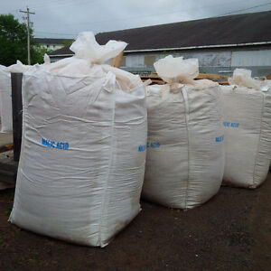 Totes of softwood shavings for animal bedding
