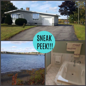 WATERFRONT HOME RIGHT IN THE CITY OF BATHURST!!!