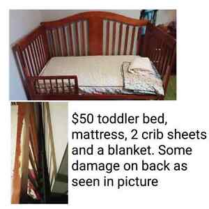 Toddler bed with mattress, sheets and blanket