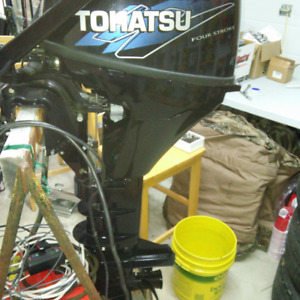 2013 Tohatsu 9.8 ,4 stroke with electric start & Troll pro 2